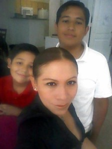 Adrian with his mother and brother (Facebook)