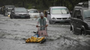 Flooding from Typhoon Usagi in China (Aaron Favila/AP)