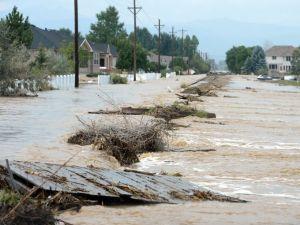 Longmont, Colorado saw extensive damage (Cliff Grassmick/AP)