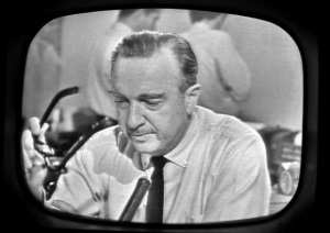 Walter Cronkite covers the story (Getty Images)