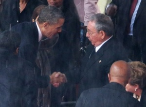 Obama shakes Castro's hand... a big no-no (Chip Somodevilla/Getty Images)