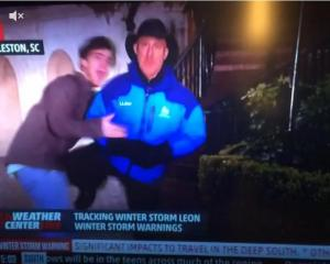 And it's Cantore to the crotch! (The Weather Channel)