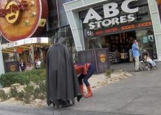 The recession hits us all... and even superheroes have to earn a buck
