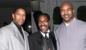 Carter with actor Denzel Washington and heavyweight champ Evander Holyfield (AP)