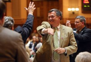 Celebrate more guns, come on! Rep. Rick Jasperse throws high fives to congratulate his pals on passing HB60 (Atlanta-Journal Constitution)
