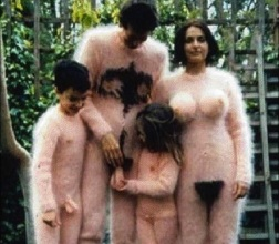 I don't know what bothers me more: the fuzzy outfits or the daughter cradling her dad's fuzzy balls (Elite Daily)